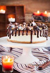 Two-ply chocolate cheesecake decorated with candie…