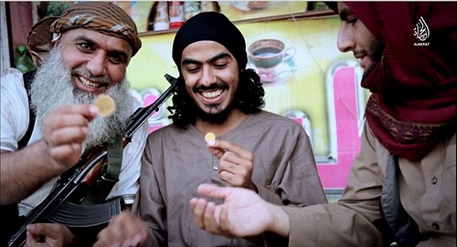 Happy ISIS goons with gold coins