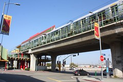train station(0.0), junction(0.0), monorail(0.0), controlled-access highway(0.0), race track(0.0), walkway(0.0), pedestrian(0.0), metropolitan area(1.0), traffic(1.0), vehicle(1.0), train(1.0), transport(1.0), road(1.0), public transport(1.0), lane(1.0), overpass(1.0), downtown(1.0), infrastructure(1.0), bridge(1.0),
