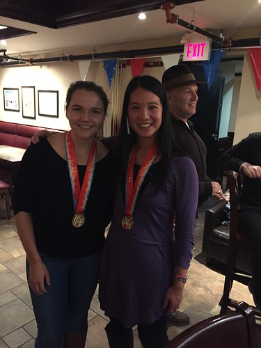 Mei and Olivia with their medals.