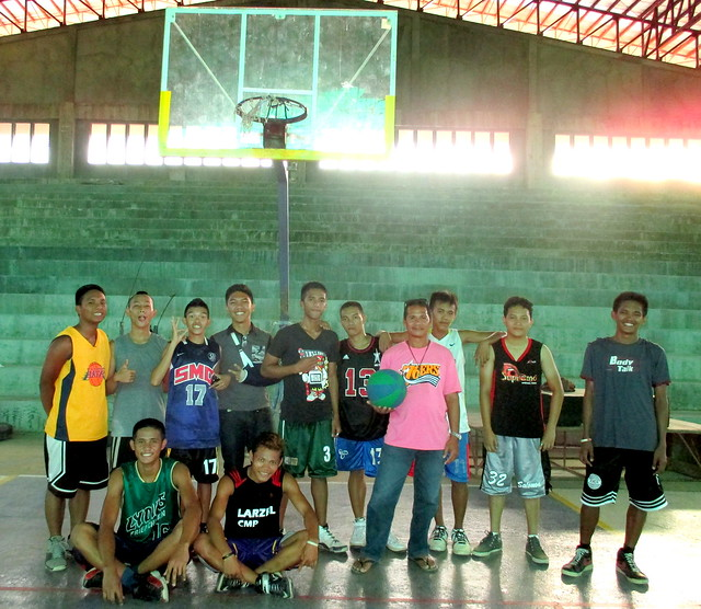 Coach Pedro gathers with local basketball players for a photo in the newly-rehabilitated Naval Civic Center - July 2015.