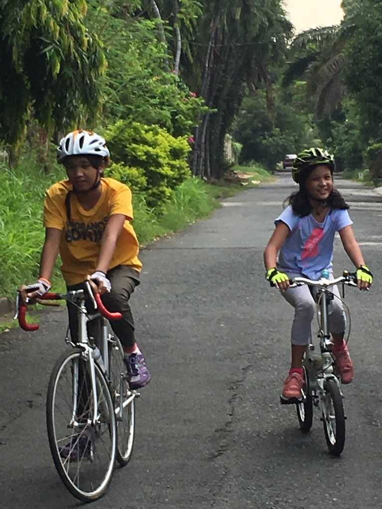 Sophia and Lily biking