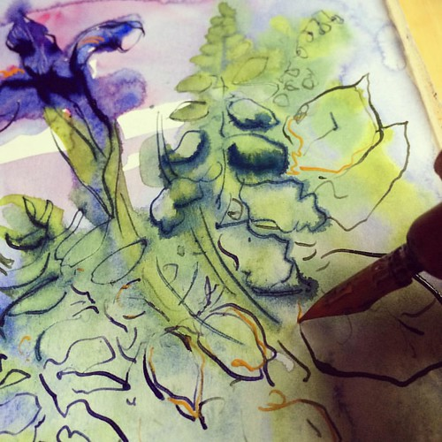 It's raining outside and I'm painting wet in wet! #watercolor #sketchbook #irises #penandink
