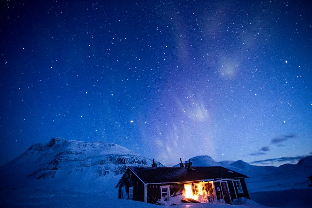 Patches of aurora above Singi STF hut near Kebnekaise. Lappland. Sweden. April 2015.
