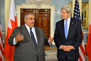 Secretary Kerry Listens as Bahraini Foreign Minister al-Khalifa Addresses Reporters After Their Bilateral Meeting in Washington