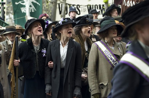 Carey Mulligan (center) shouts with her early-20th-century British cohorts in SUFFRAGETTE.