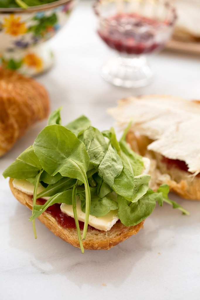 arugula and brie on open croissant for panini