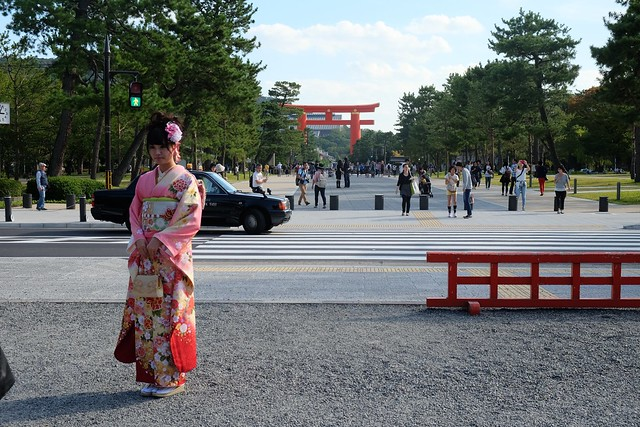 Japanese lady poses in front of Torii Gate