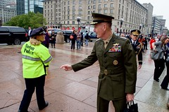 Chairman of the Joint Chiefs of Staff Marine Corps General Joseph Dunford, Jr. speaks with a Boston Police Officer on October 13, 2015, outside the Boston Public Library in Boston, Massachusetts, before the Quincy native and Boston College High School graduate attended annual AUSMIN diplomatic and defense meetings with U.S Secretary of State John Kerry and U.S. Defense Secretary Ash Carter. [State Department photo/ Public Domain]