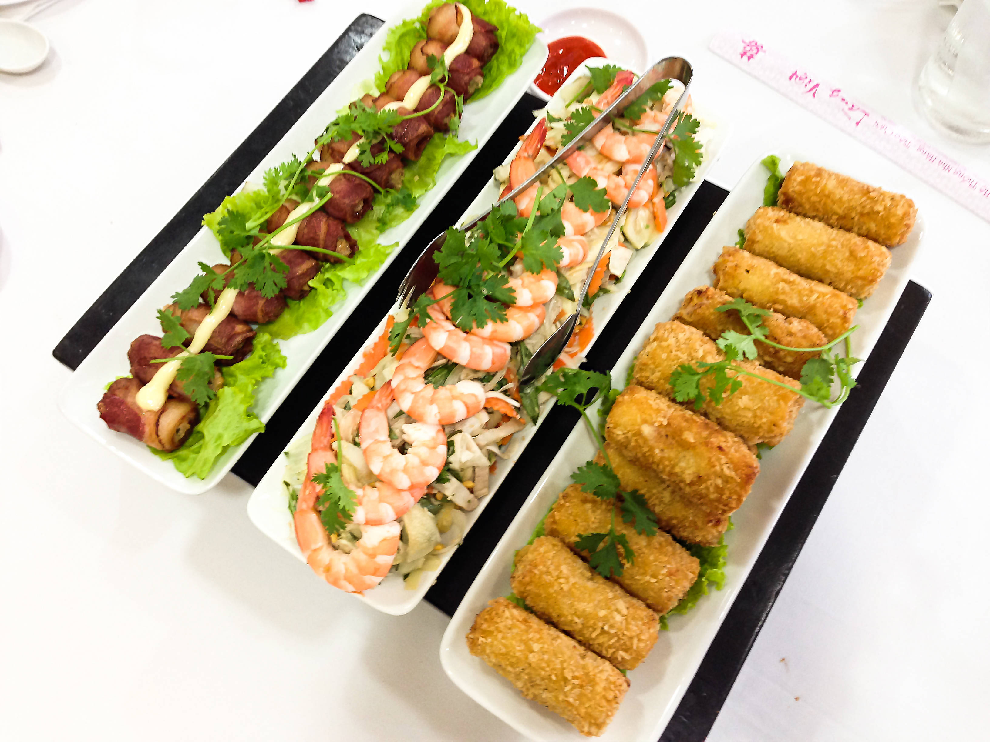 French style spring rolls, shrimp salad and jambon rolls with grilled fish