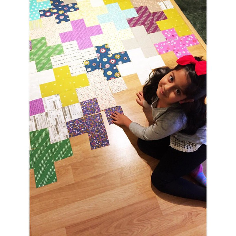 She insisted on getting this laid out juuuust right💗➕➕😀 #quiltelf #celebratehandmade #cottonandsteel #incolororder #plusquilt #makeallthethings #quilt