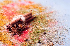 cinnamon, anise lie on scattered spices