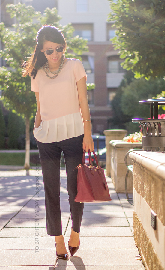 gray silk wrapped pearl necklace, colorblock tee, navy pants, red purple tote, burgundy pumps