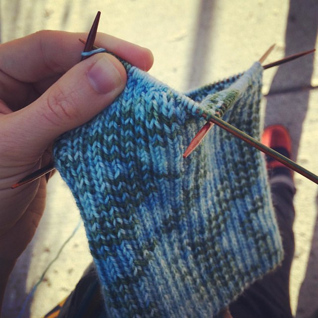 Knitting while walking home from the bus. 2x2 rib is perfect for mindless knitting to keep my hands busy!