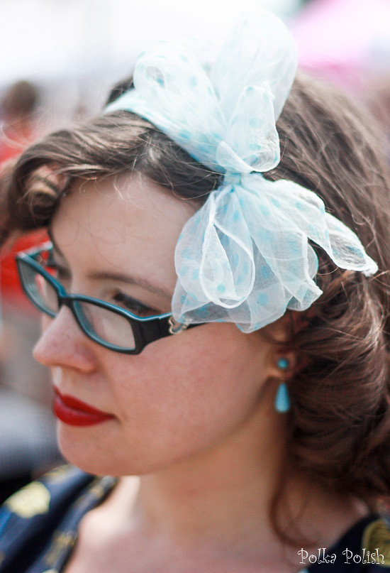 Staying cool for summer with a polka dot chiffon scarf tied in a big bow