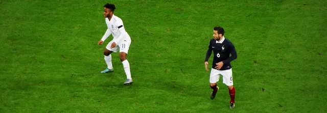 Raheem Sterling of England and Yohan Cabaye of France