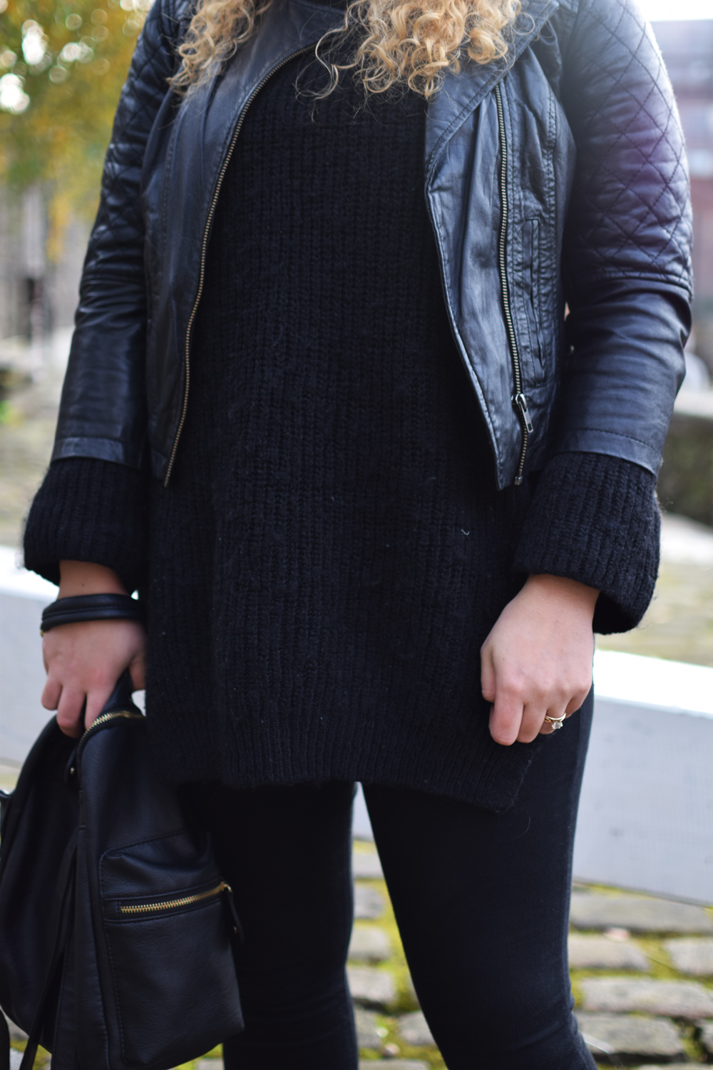 all black leather jacket and knit jumper