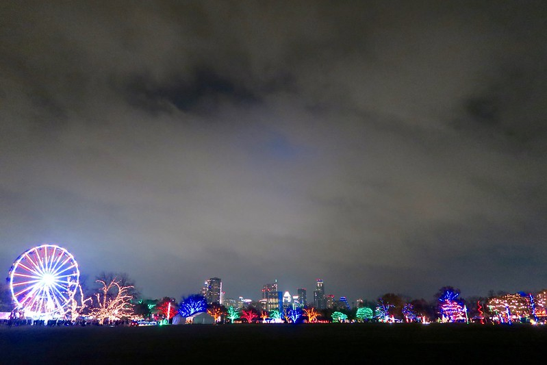 trail of lights under austin skyline