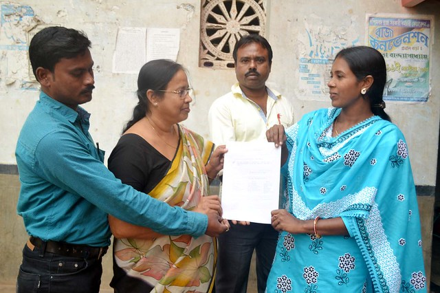 Bebida Khatun shows her letter to attend the award ceremony