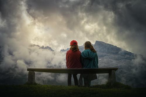 tannalp switzerland mountains sisters bench clouds landscape outdoor girls sitandwait