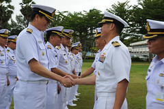 Capt. H.B. Le, commodore of Destroyer Squadron (DESRON) 7, shakes hands with Royal Thai Navy sailors at the opening ceremony of Cooperation Afloat Readiness and Training (CARAT) Thailand 2015. (U.S. Navy/MC2 Chelsy Alamina)