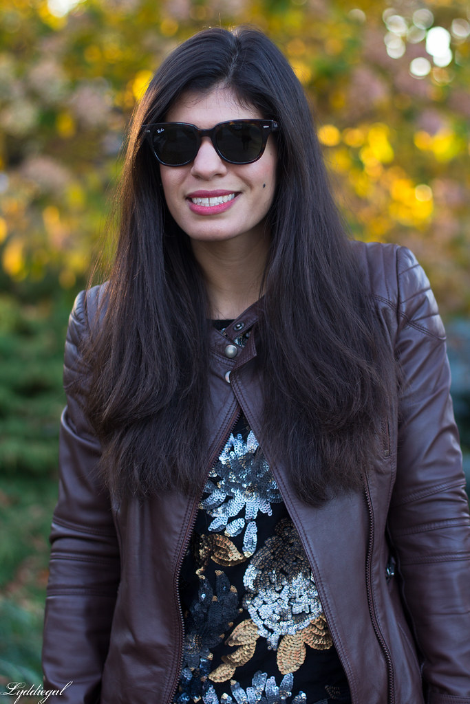 sequined sweater, brown leather jacket, jeans.jpg