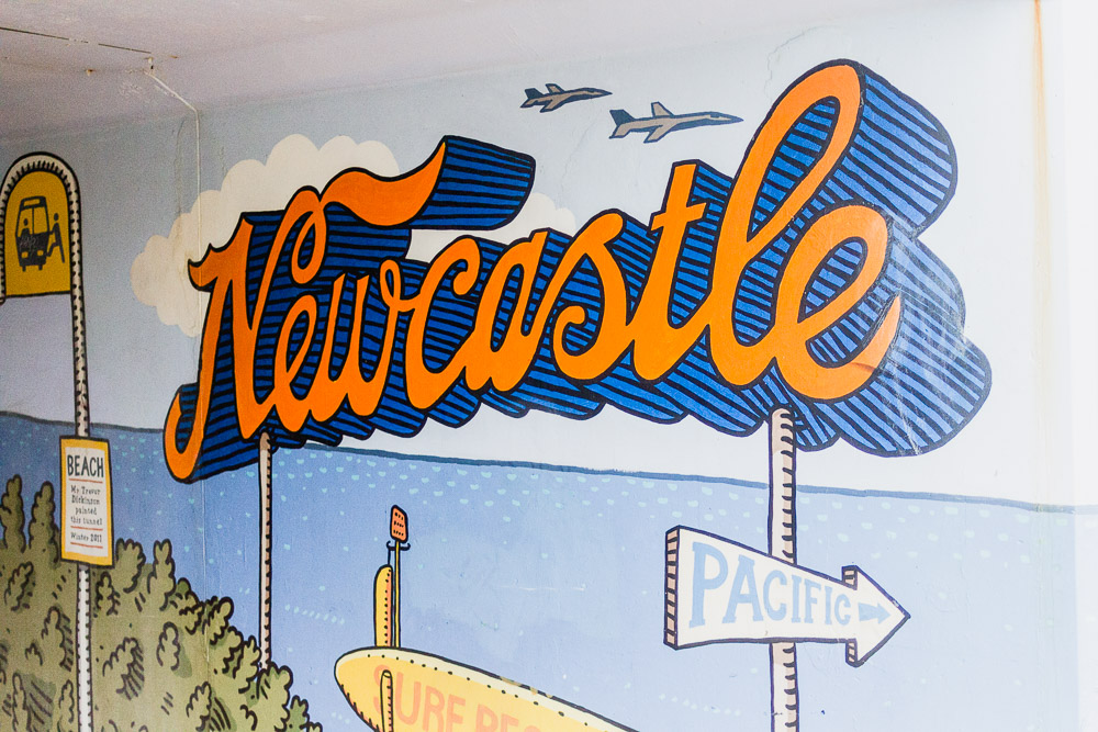 newcastle mural lettering in a subway