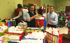 Club members gathering up gift bags to hand out at the Total Life Center.