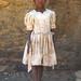 Tanzania, Serengeti Plateau, Lake Eyasi, hadzabe tribe girl with modern clothes by Eric Lafforgue