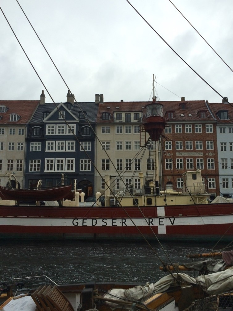 Nyhavn canal boat Gedser Rev in front of colorful buildings Copenhagen