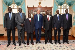 U.S. Secretary of State John Kerry poses for a photo with South Sudanese Vice President James Wani Igga, Dr. Riek Machar Teny, and Pagan Amum Okiech, Representing Signatories to the Agreement on the Resolution of the Conflict in South Sudan, at the U.S. Department of State in Washington, D.C., on October 7, 2015. [State Department photo/ Public Domain]