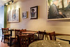 Well know Coffee Shop on the High Street,very sparse ,but i liked the photos on the wall ! by I.T.P.