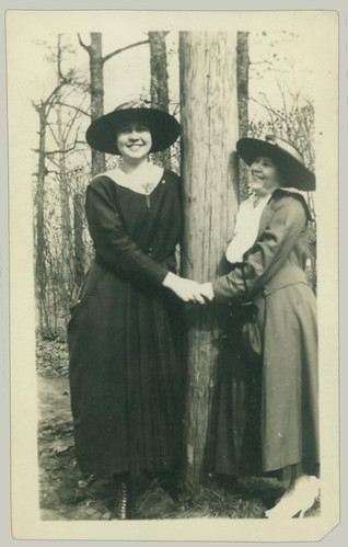 Two ladies hugging a tree