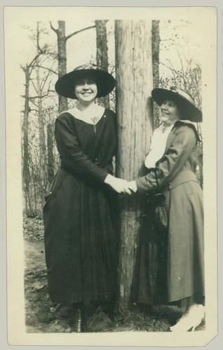 Two ladies hugging a tree