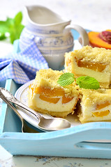 Pieces of peach pie with curd.