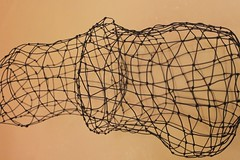 wire fencing(0.0), home fencing(0.0), barbed wire(0.0), fence(0.0), branch(0.0), wire(0.0), sketch(0.0), drawing(0.0), drum(0.0), chain(0.0), iron(0.0), hand drum(0.0), circle(0.0), twig(0.0), art(1.0), net(1.0),