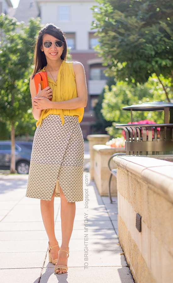 mustard yellow top, brocade wrap skirt, orange clutch, raffia heels