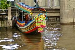 Dragon boat at the Saphan Taksin pier on the Chao Phraya river in Bangkok, Thailand