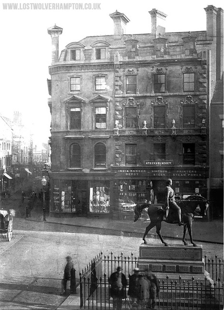 The Prince pictured in his original position in January 1867, in the background are Messrs Steen & Blackets Printing works.