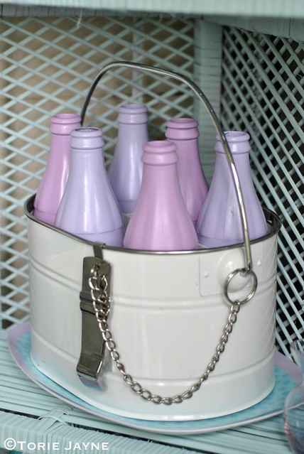 Bottle carrier filled with spray pianted bottles