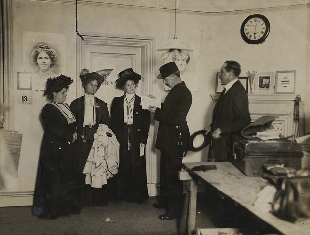 The arrest of Flora Drummond, Emmeline and Christabel Pankhurst, WSPU offices at Clement's Inn, 1908. Credit: LSE Library