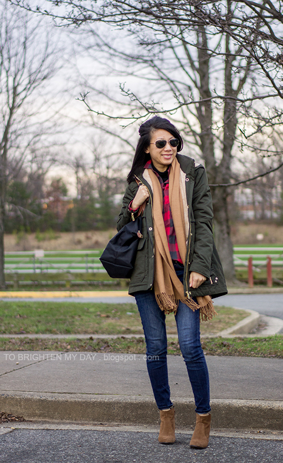 olive green parka, camel scarf, buffalo red check shirt, brown suede ankle boots
