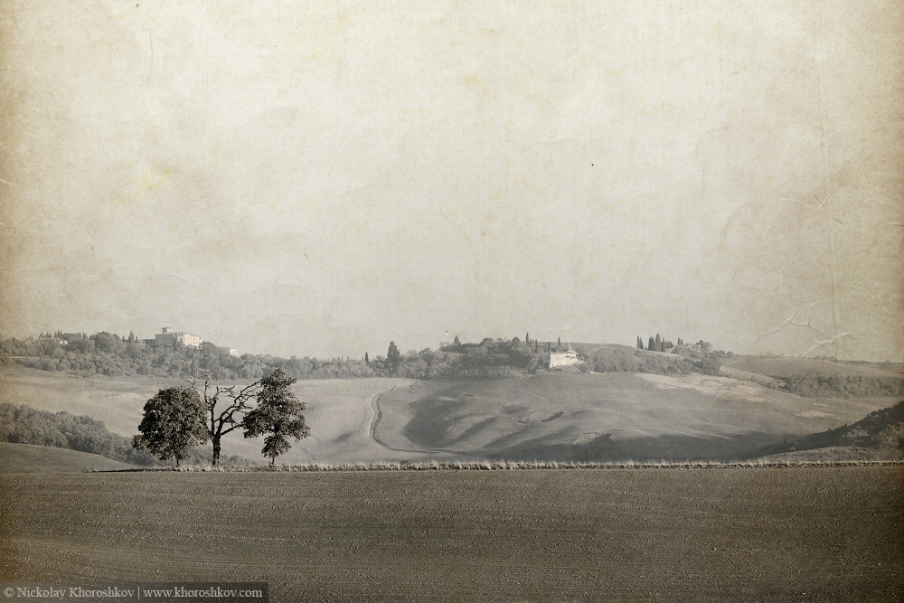 Vintage style image of valley of fields and hills