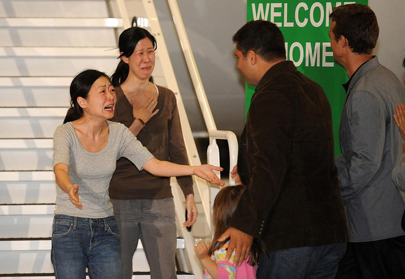 Journalists Euna Lee and Laura Ling, arrested in North Korea, are reunited with their families