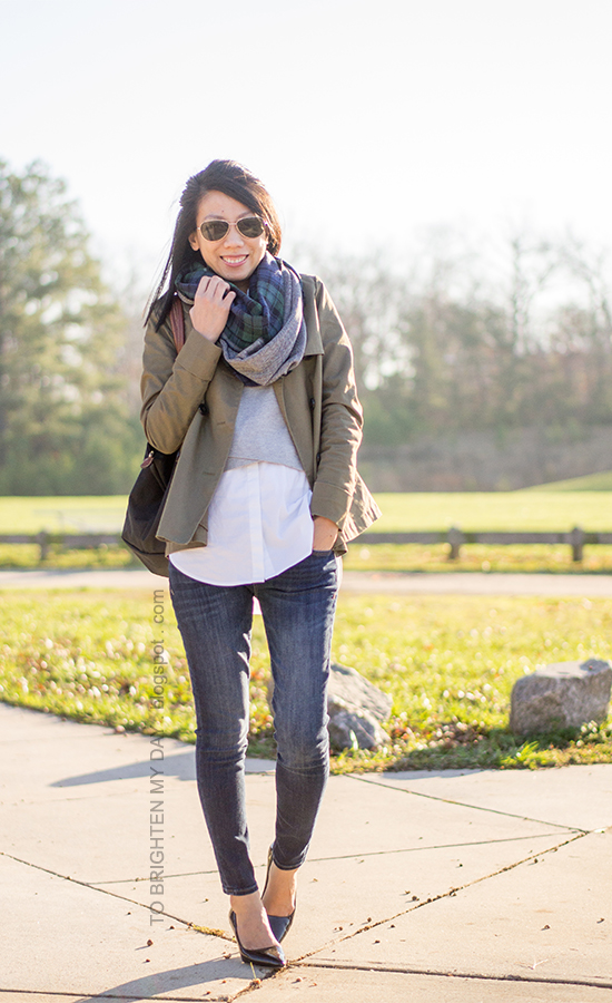 green plaid and herringbone infinity scarf, green swing trench jacket, gray vest, white button up shirt, skinny jeans, black pumps