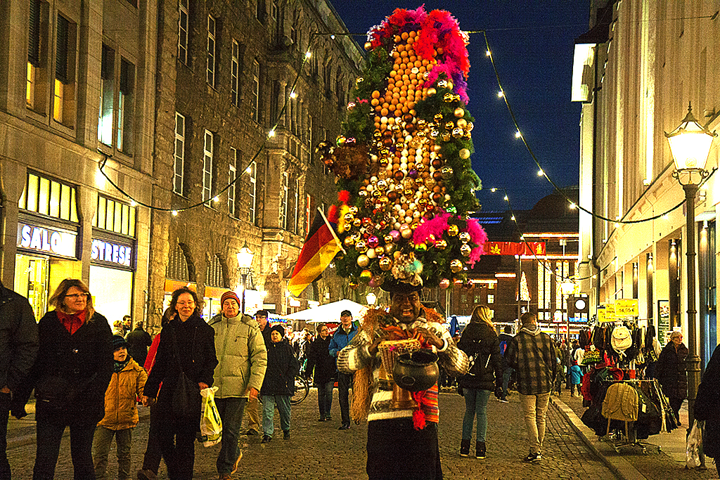 Conga player with enormous Christmas headdress--Leipzig
