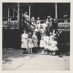 Large family poses on the stairs of their house