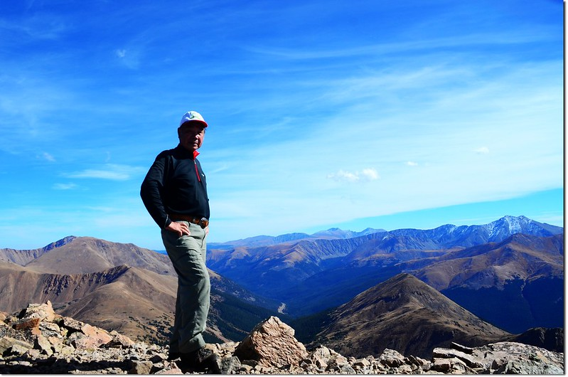 Me on the summit of Pettingell, in the background are Mount Evans et al. 14ers