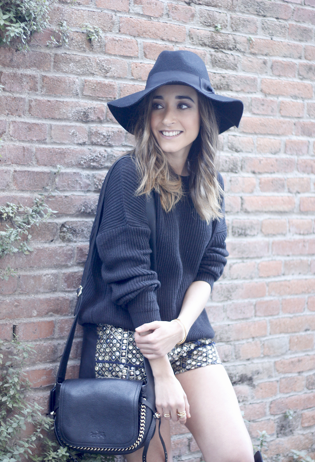 embroidered shorts black hat over the knee boots black sweater pull and bear purse coach outfit15