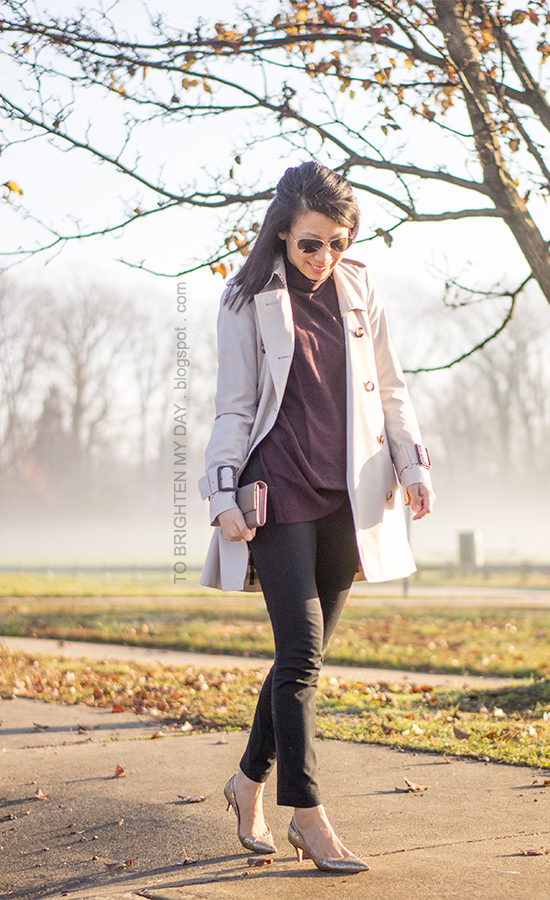 trench coat, plum tunic sweater, taupe clutch, black pants, glitter pumps